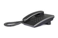 有被环绕的按钮的桌面黑电话 特写镜头 免版税库存照片