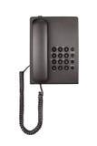 有被环绕的按钮的桌面黑电话 特写镜头 免版税库存图片