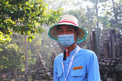 有被盖的嘴的柬埔寨男孩 免版税库存照片