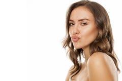 有被缩拢的嘴唇的妇女 免版税库存图片