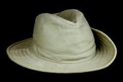 有被转动的边缘的布什帽子黑背景的 库存图片