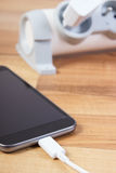 有被连接的插座的手机充电器,智能手机充电 免版税图库摄影