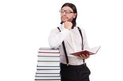 有被隔绝的书的滑稽的学生 免版税库存图片