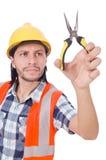 有被隔绝的少年的年轻建筑工人  免版税库存图片