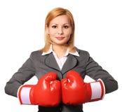 有被隔绝的拳击手套的女商人 免版税库存照片