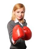 有被隔绝的拳击手套的女商人 免版税库存图片