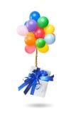 有被隔绝的礼物的颜色气球 免版税库存图片