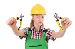 有被隔绝的钳子的建筑工人女性 库存照片
