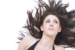 有被风吹头发的美丽的妇女 免版税库存图片