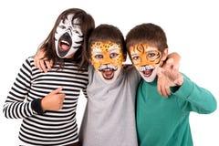 有被绘的面孔的孩子 免版税图库摄影