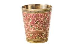有装饰品的古铜色杯子在白色背景 免版税库存照片