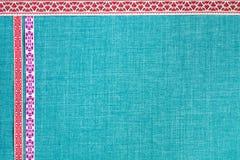 有装饰品的磁带在与空的空间的织品背景 全国精神 免版税库存图片