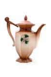 有装饰品花的米黄瓷茶壶 图库摄影
