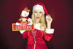 有装饰的美丽的圣诞节女孩 库存照片