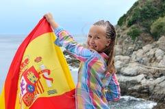 有西班牙旗子的女孩 免版税库存图片