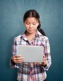 有触摸板的亚裔女孩 库存照片