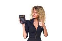 有计算器的女商人 库存照片