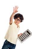 有计算器的逗人喜爱的混合的族种男孩。 免版税图库摄影