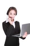 有计算机的女商人 免版税库存照片