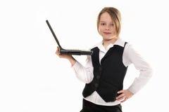 有计算机的女孩在空白背景 库存照片