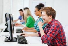有计算机的学生学习在学校的 图库摄影