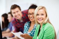 有计算机的学生学习在学校的 免版税图库摄影