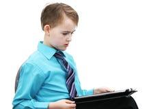 有计算机的男孩 免版税库存照片