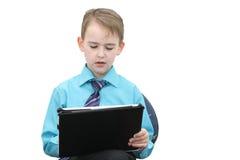 有计算机的男孩 免版税图库摄影