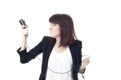 有计算机老鼠的被注重的女实业家 免版税图库摄影