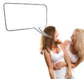 有讲话泡影的两名欧洲妇女 免版税图库摄影