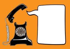 有讲话泡影的老电话 免版税库存图片