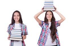 有许多书的学生女孩在白色 免版税库存图片