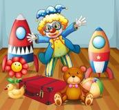 有许多玩具的一个小丑 皇族释放例证