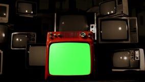有许多电视的老红色电视绿色屏幕 背景去黑色 乌贼属口气 影视素材