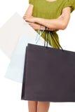 有许多的一名妇女购物袋 免版税库存图片