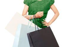 有许多的一名妇女购物袋 免版税图库摄影