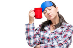 有设法一个的杯子的女孩咖啡醒和振作起来 库存图片