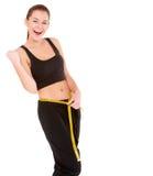 有评定磁带的健身妇女 免版税库存照片