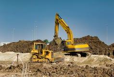 有词工作的挖掘机和推土机玩具 免版税库存图片
