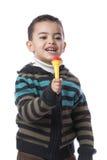 有话筒的小男孩 库存照片