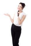 有话筒的年轻女性主持人在白色背景 免版税库存照片