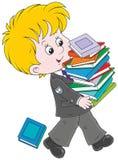 有课本的男小学生 免版税库存图片