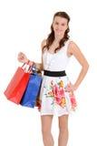 有购物袋的愉快的青少年的女孩 库存照片