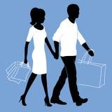 有购物袋的男人和妇女 库存照片