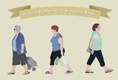 有购物袋的老妇人 免版税库存图片