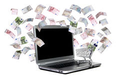 有购物车和飞行欧元的膝上型计算机 免版税库存照片