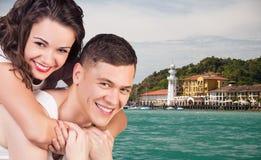 有赞许的妇女在海滩baclground 免版税库存图片