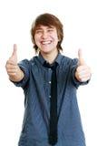 有赞许的微笑的年轻人 图库摄影