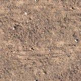 有起动道的无缝的含沙道路 背景,纹理 库存照片