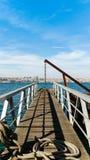有起重机的码头 免版税图库摄影